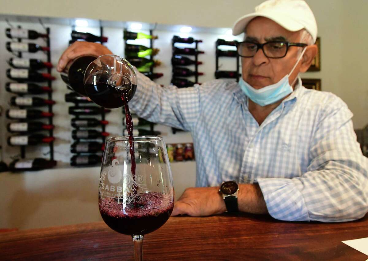 Owner Abby Youghabi pours a glass of Cabernet Sauvignon at Sabba Vineyard on Friday, Oct. 9, 2020 in Old Chatham, N.Y. (Lori Van Buren/Times Union)
