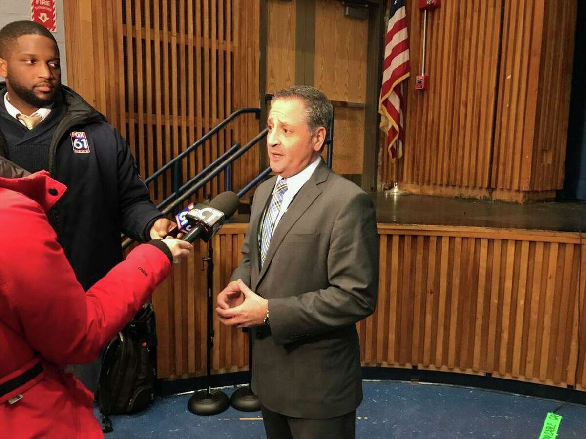 In this file photo, Wallingford Superintendent of Schools Salvatore Menzo answers questions from reporters during a 2019 Board of Education meeting.