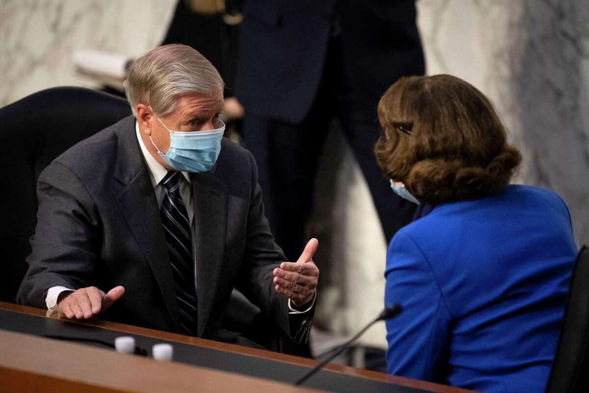 Chairman Lindsey Graham, R-S.C., left, and ranking member Dianne Feinstein, D-Calif., talk before the confirmation hearing for Supreme Court nominee Amy Coney Barrett at the Senate Judiciary Committee on Capitol Hill in Washington, Monday, Oct. 12, 2020.