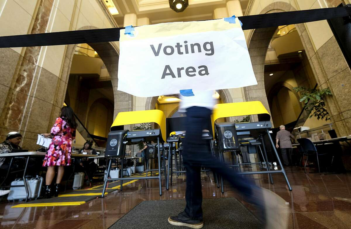 In this March 3, 2020 file photo, voters cast their ballots in the California Primary on Super Tuesday at a voting center at Union Station in Los Angeles. (AP Photo/Ringo H.W. Chiu, File)