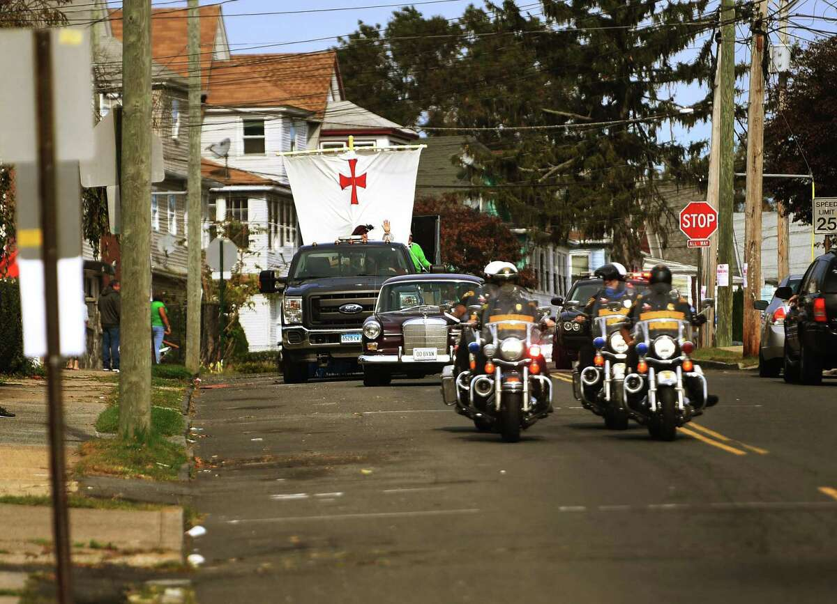 Bridgeport police lead the annual Columbus Day Parade on Wayne Street in Bridgeport, Conn. on Sunday, October 11, 2020. This year's parade was scaled down dramatically due to the Covid-19 pandemic.