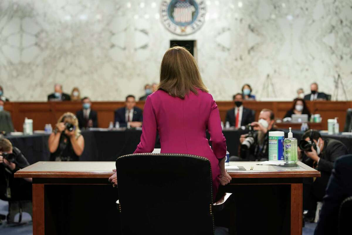 Supreme Court nominee Amy Coney Barrett arrives for her Senate Judiciary Committee confirmation hearing before the Senate Judiciary Committee on Capitol Hill in Washington, Monday, Oct. 12, 2020. (Greg Nash/Pool via AP)