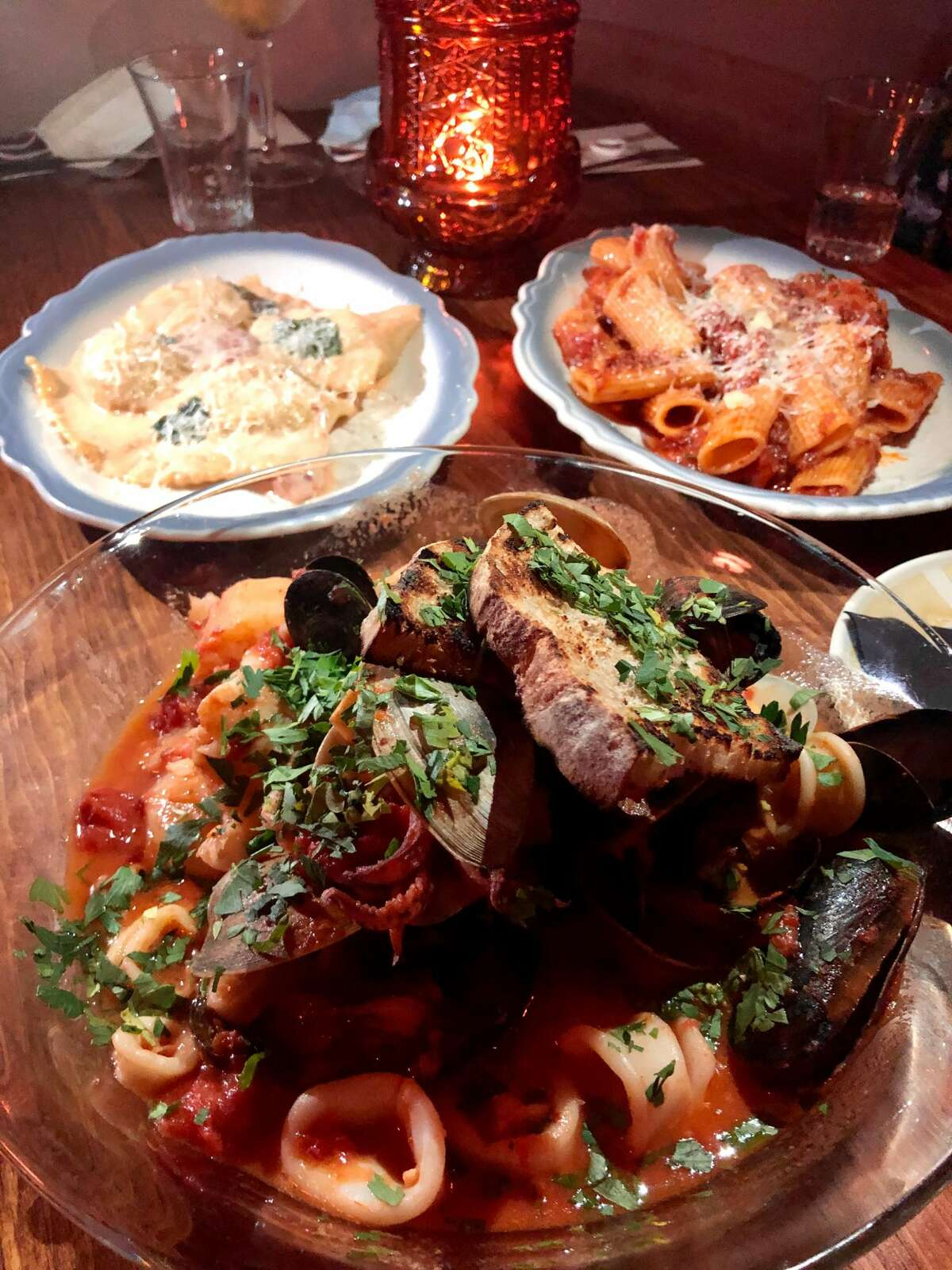 Among the savory dishes at Rosanna's in Albany are, clockwise from top, ravioli alla Rosanna, pasta Bolognese and zuppa di pesce. (Photo by Susie Davidson Powell for the Times Union.)