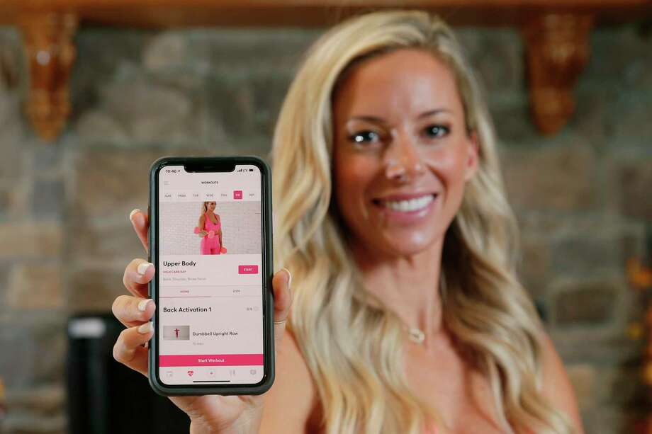 "Lindsay Huelse, creator of the smart phone fitness app ""The Fitt Cycle"", shows off one of the workout routines on her phone Friday, Oct. 9, 2020 in Magnolia, TX. Photo: Michael Wyke / Contributor / © 2020 Houston Chronicle"