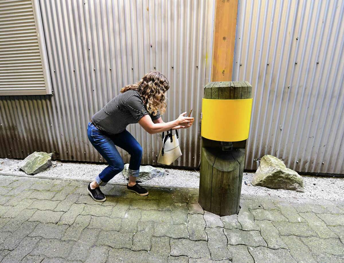 """Renee Iaci tracks down a clue during the Vancouver Fringe Festival premiere of """"Art Heist."""" The interactive performance and walking tour is making its U.S. debut with shows in San Antonio and Austin."""