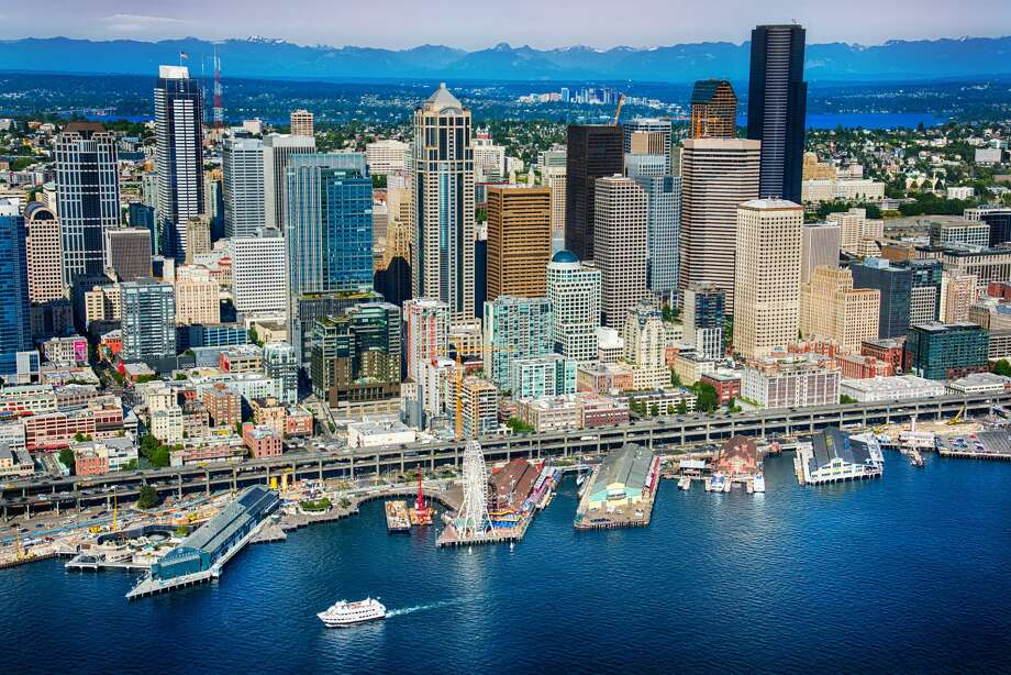 The beautiful downtown area of Seattle Washington with it's iconic waterfront in the foreground and the skyline of Bellevue in the distance. I shot this image from an altitude of about 600 feet over the Puget Sound during a helicopter photo flight. Photo: Art Wager/Getty Images / Art Wager