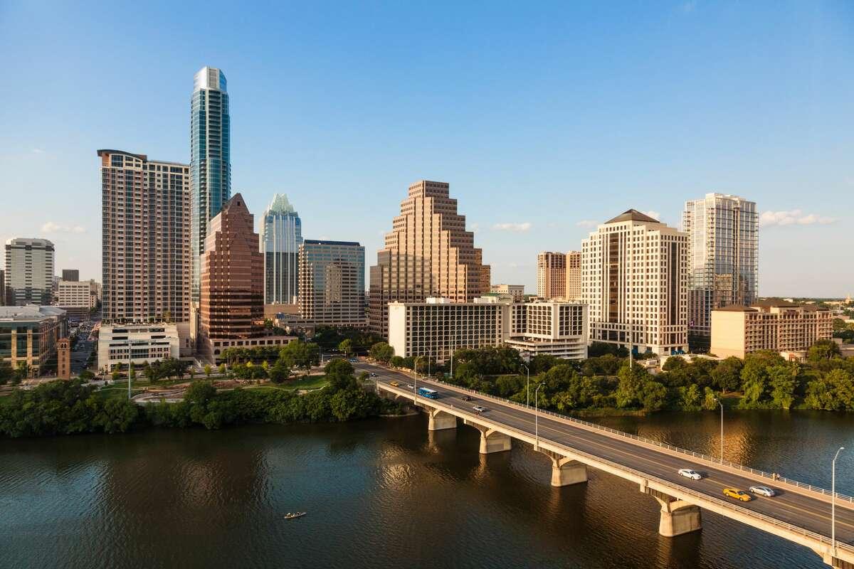 Texas skyline including Congress Avenue bridge over Ladybird Lake, Austin.