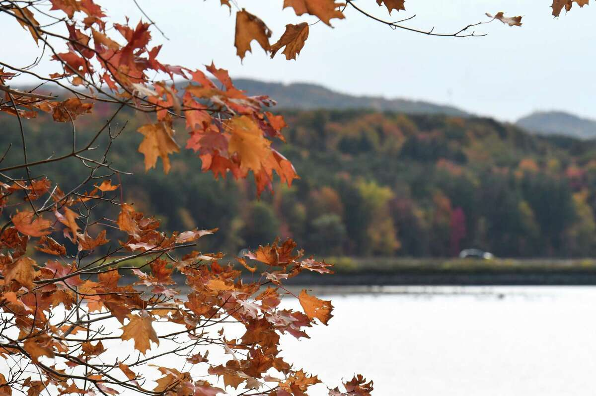Fall colors decorate the landscape at Tomhannock Reservoir on Monday, Oct. 12, 2020, in Pittstown, N.Y. (Will Waldron/Times Union)