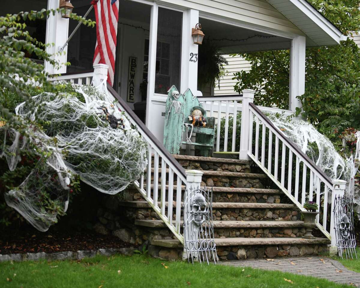 Homes are decorated with spooky Halloween decorations in the Hubbard Heights neighborhood of Stamford, Conn. Monday, Oct. 12, 2020.