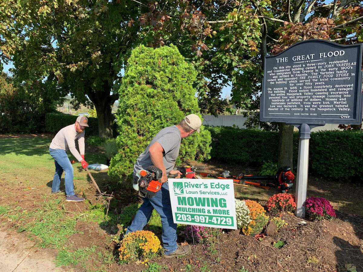 Members of the Vartelas/Stamos family and River's Edge Lawn Services cleaned up and planted fresh flowers and shrubs in Vartelas Park at the foot of the Maple Street bridge in Ansonia Saturday.