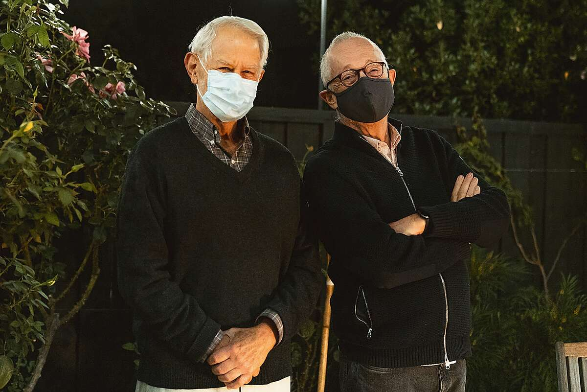 In this Monday, Oct. 12, 2020 photo provided by Stanford University, Robert Wilson, left, and Paul Milgrom wear masks as they stand for a photo in Stanford, Calif. The two American economists, both professors at Stanford, won the Nobel Prize in Economics for improving how auctions work. That research that underlies much of today's economy - from the way Google sells advertising to the way telecoms companies acquire airwaves from the government.