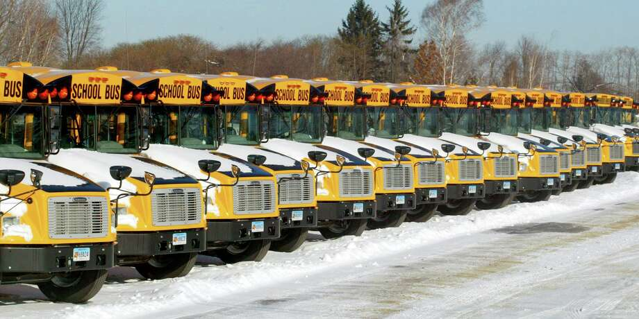 School buses covered in snow in Connecticut. Photo: Hearst Connecticut Media / Connecticut Post File Photo