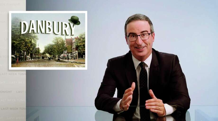 "This video frame grab shows John Oliver from his ""Last Week Tonight with John Oliver"" program on HBO, Sunday, Aug. 30, 2020. On Aug. 22, Danbury, Conn., Mayor Mark Boughton announced a tongue-in-cheek move posted on his Facebook page to rename Danbury's local sewage treatment plant after Oliver following the comedian's expletive-filled rant about the city. Oliver then offered to donate $55,000 to charity if the city actually followed through with it. On Thursday, Oct. 8, the Danbury City Council voted 18-1 to rename the sewage plant after the comedian. Photo: Associated Press / HBO"