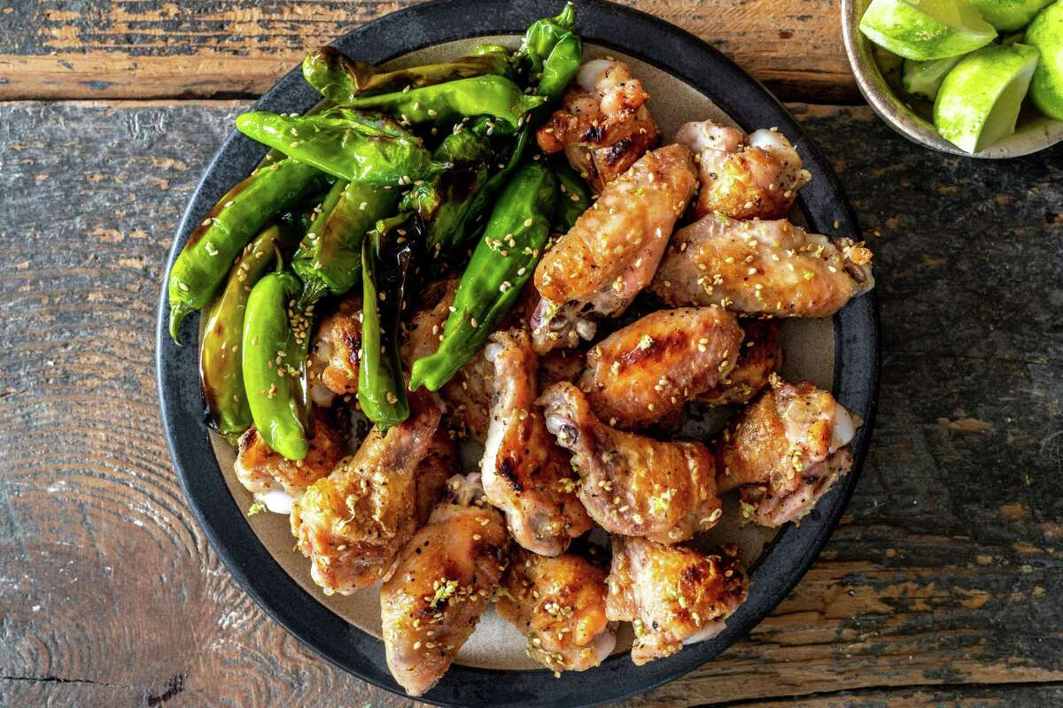 Crispy Chicken Wings With Shishito Peppers.