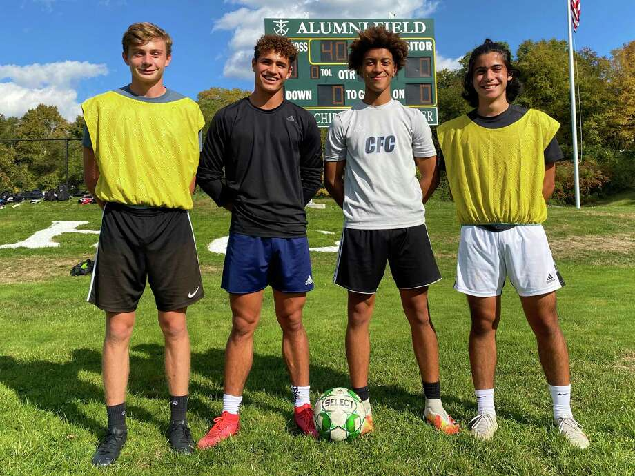 Holy Cross soccer players Patrick Osiecki, Jaden Paniagua, Kadin Talho and Giuseppe Mongelluzzo. Osieicki and Paniagua are transfers from Chase Collegiate joining the All-State duo of Talho and Mongelluzzo. Photo: Scott Ericson / Hearst Connecticut Media