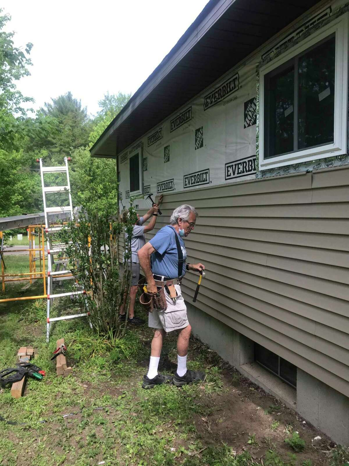 Volunteer Ken Smith helps with a remodel project at Habitat for Humanity. Smith volunteers on builds and at the Restore in Big Rapids, as well as serving on the American Red Cross disaster aid team. (Submitted photo)