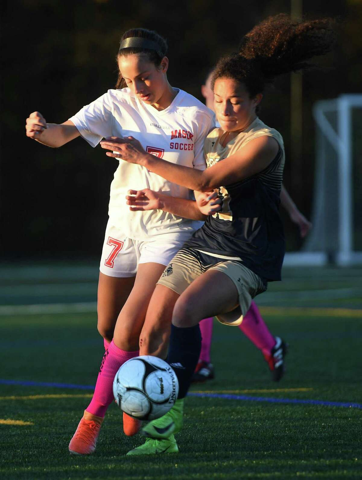 Masuk's Amanda Campos, left, and Notre Dame of Fairfield's Toni Domingos battle for the ball during their 0-0 tie SWC girls soccer match in Fairfield, Conn. on Monday, October 28, 2019.