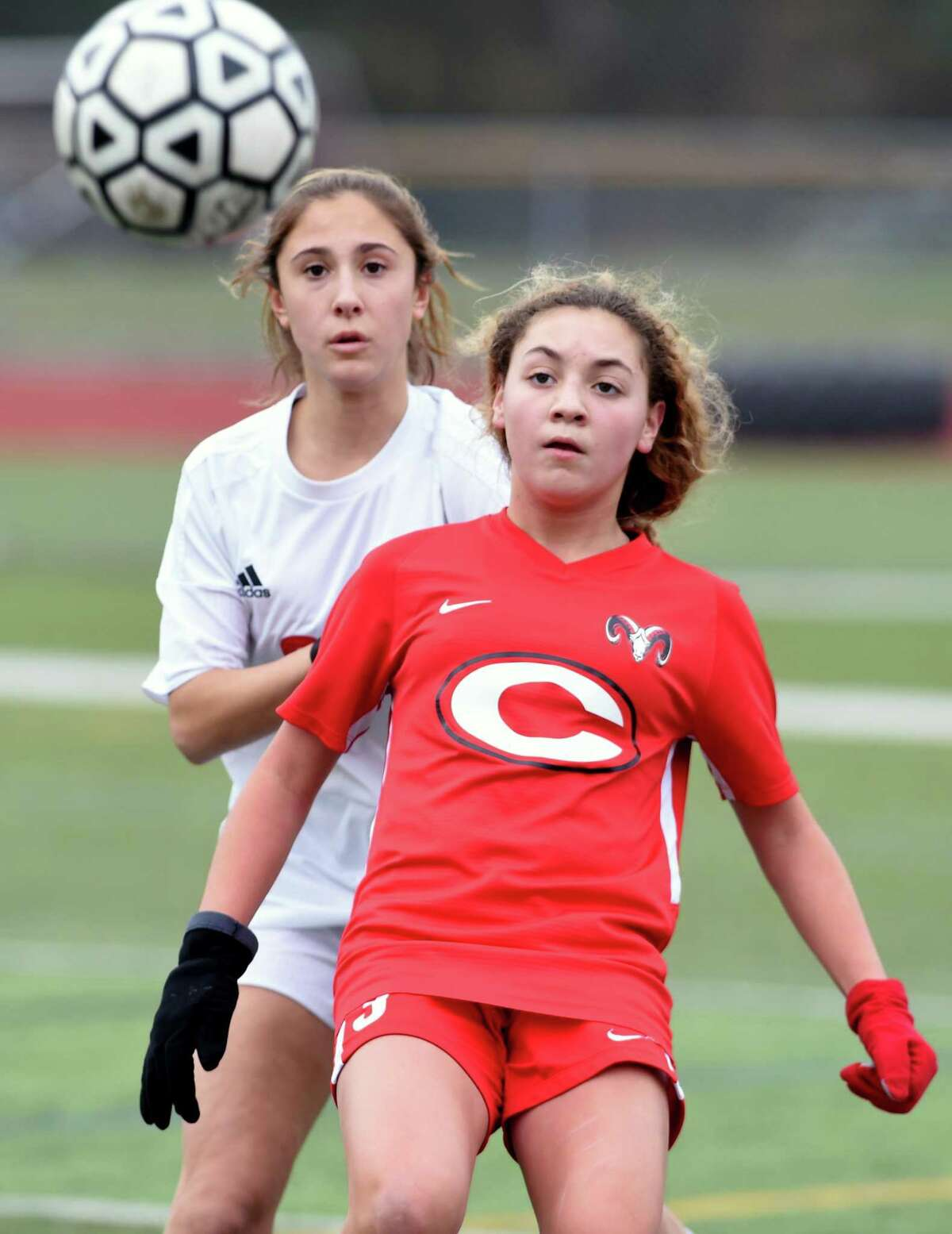 Anna Zoccolillo (left) of New Canaan and Gabriella Tirado of Cheshire maneuver for position on November 14, 2019 in a Class LL tournament game in Cheshire.