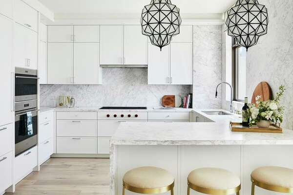 High-end appliances and stone counters outfit the chef's kitchen at the Crescent's penthouse in Nob Hill.