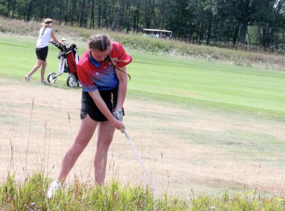 Chippewa Hills' Ryleigh Allen hits out from rough in a match at The Pines in Canadian Lakes earlier this season. (Pioneer file photo)