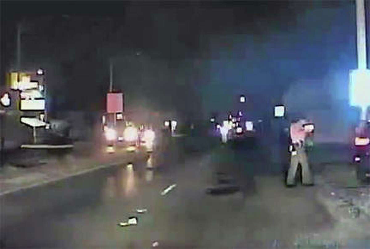 An 8-year-old girl and another passenger were able to exit a vehicle just in time before it took off dragging two Illinois State Police officers before hitting a bus terminal.