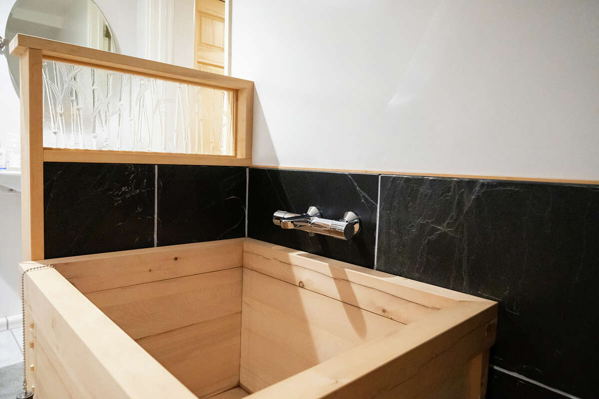 Guests can soak in a Japanese ofuro, a wooden bathtub.