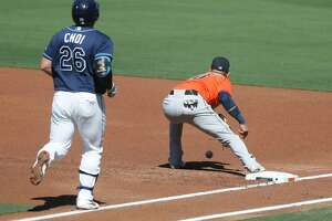 Tampa Bay Rays Ji-Man Choi reaches on a throwing error by second baseman Jose Altuve during the first inning of Game 2 of the American League Championship Series at Petco Park, Monday, October 12, 2020, in San Diego.