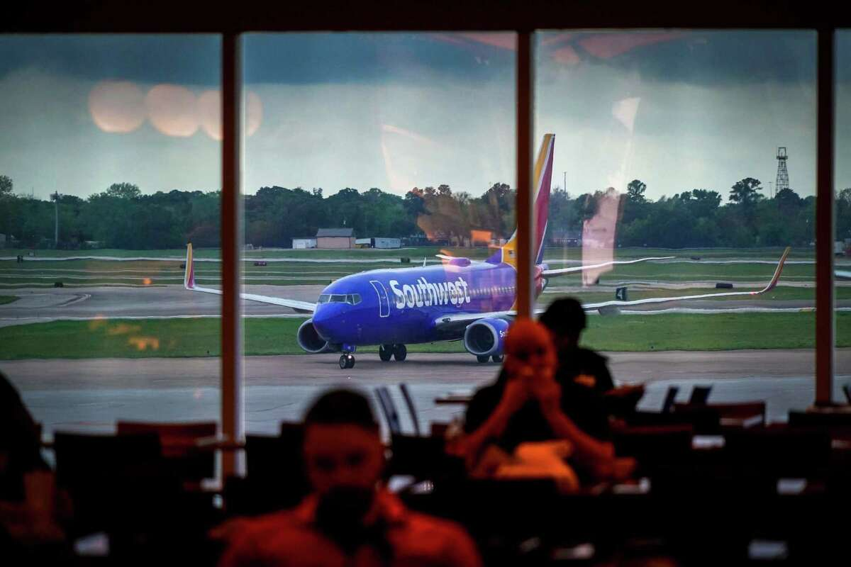 A Southwest Airlines plane taxis to the gate at Hobby Airport in Houston on Friday, March 20, 2020. The airline CEO Gary Kelly says the Dallas-based carrier plans to be flying out of Houston's George Bush Intercontinental Airport and to all of its international destinations in 2021.