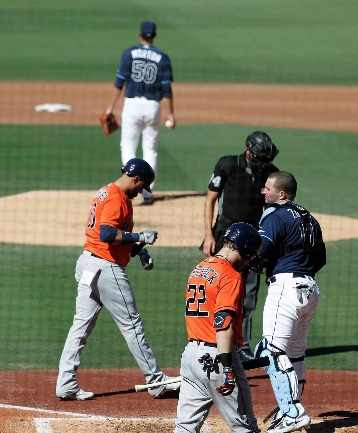 Houston Astros Yuli Gurriel (10) reacts after being hit by a pitch from Tampa Bay Rays starting pitcher Charlie Morton (50) during the third inning of Game 2 of the American League Championship Series at Petco Park, Monday, October 12, 2020, in San Diego.