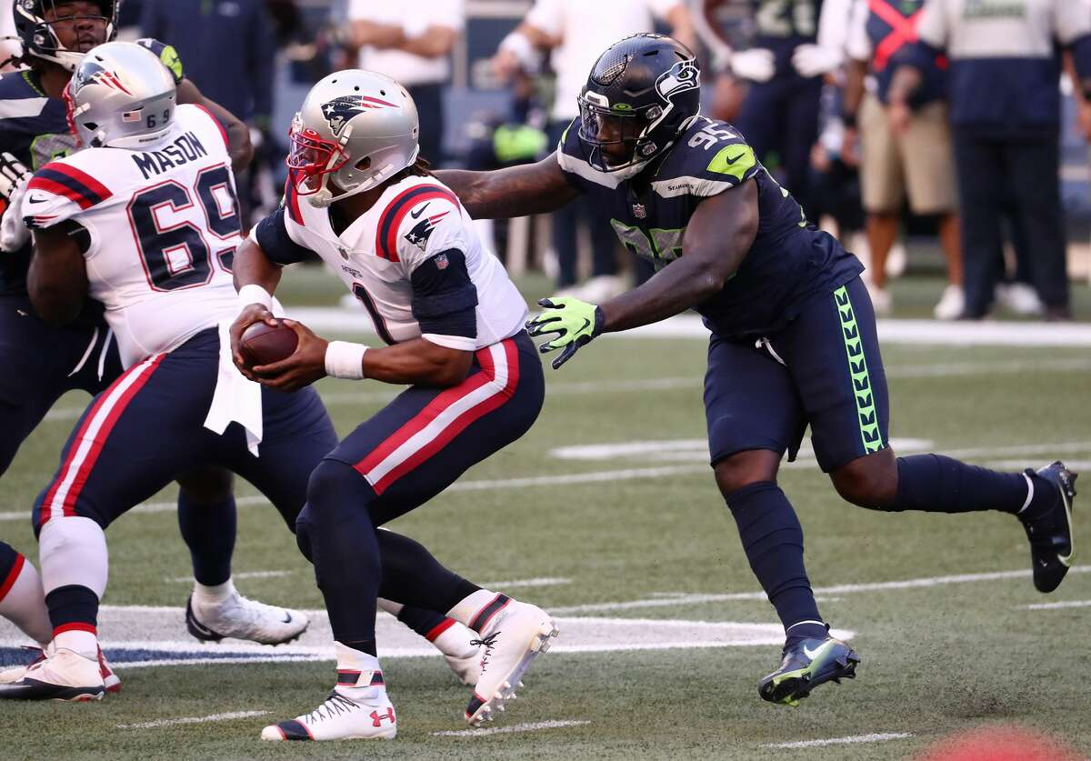 SEATTLE, WASHINGTON - SEPTEMBER 20: Benson Mayowa #95 of the Seattle Seahawks attempts to tackle Cam Newton #1 of the New England Patriots during the first half at CenturyLink Field on September 20, 2020 in Seattle, Washington. (Photo by Abbie Parr/Getty Images)
