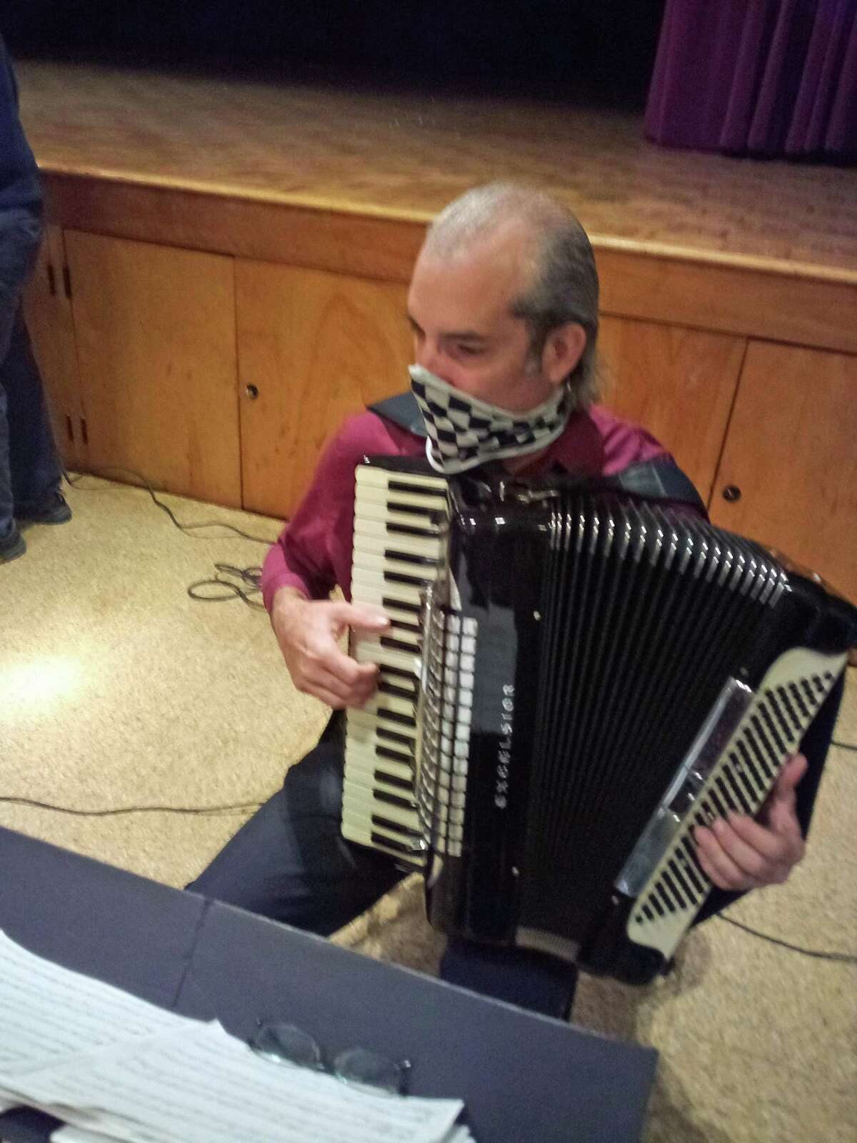 Torrington resident Marie Soliani was named the city's Italian Mayor of the Day Monday, during a ceremony at Coe Memorial Park's Civic Center. Above, Chris Cogliano plays the accordion at the celebration.