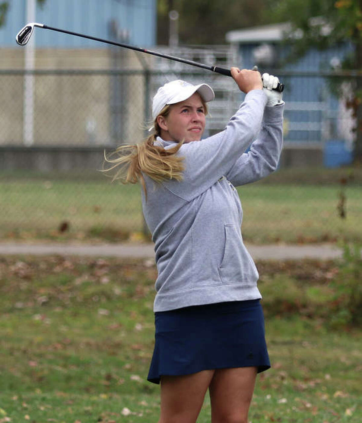 Father McGivney's Julis Stobie watches her tee shot on No. 7 at the Salem Country Club during Monday's sectional.