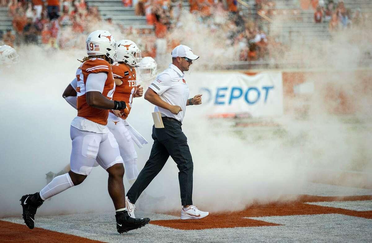 Texas coach Tom Herman takes the field with his team for an NCAA college football game against UTEP in Austin, Texas, Saturday, Sept. 12, 2020. (Ricardo B. Brazziell/Austin American-Statesman via AP)