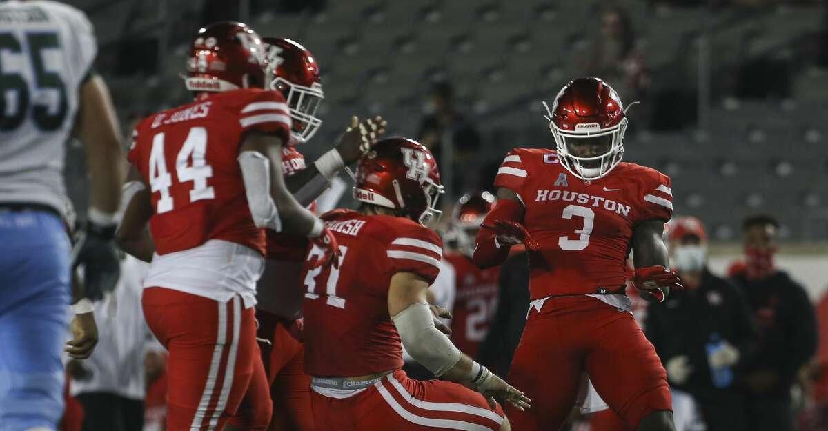 Houston Cougars celebrate defensive lineman Derek Parish's (31) sack over Tulane Green Wave quarterback Michael Pratt during the third quarter of a American Athletic Conference game Thursday, Oct. 8, 2020, at TDECU Stadium in Houston.