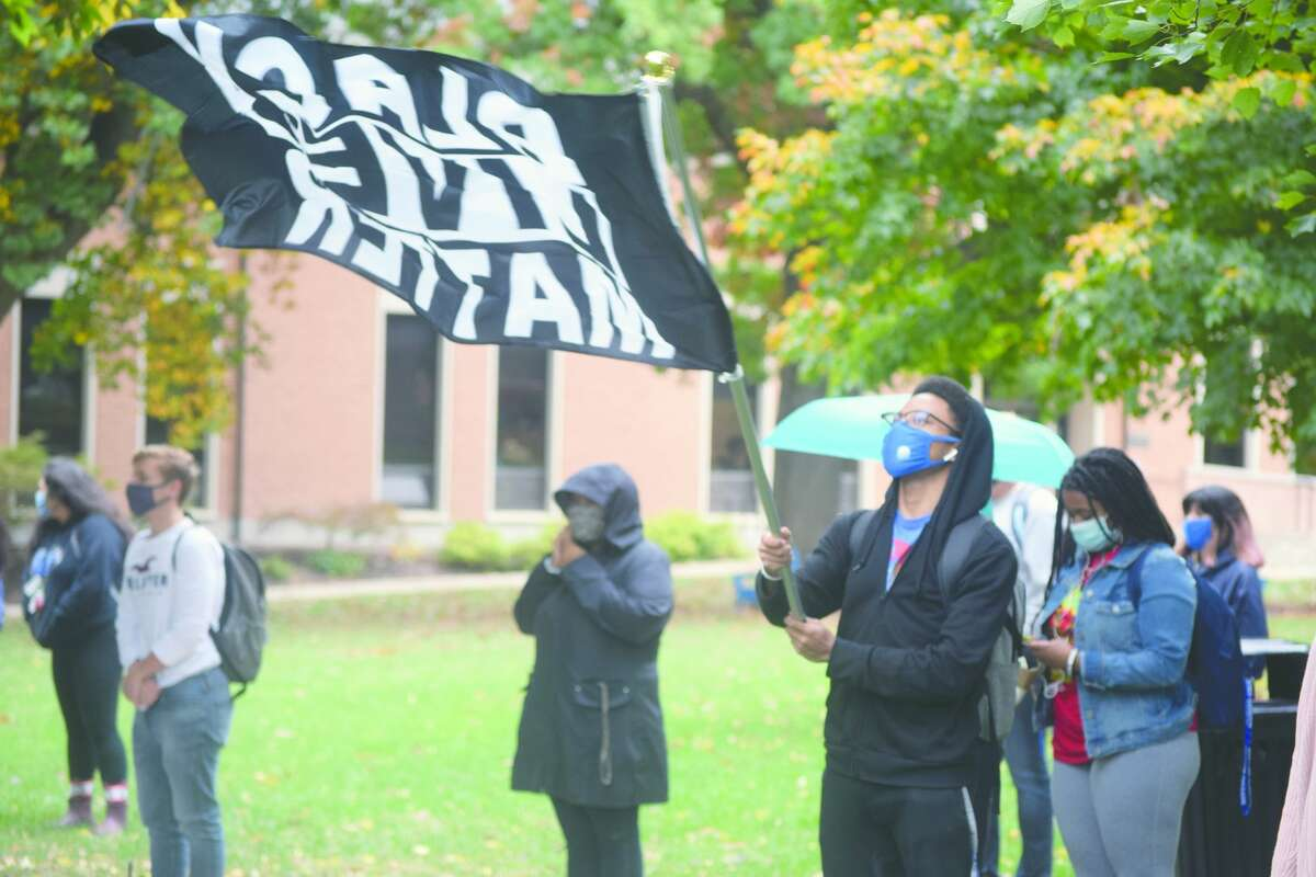 Members of the Illinois College community gather Monday on the northern quad of the school's campus, outside Tanner Hall, to support the Black Lives Matter movement.