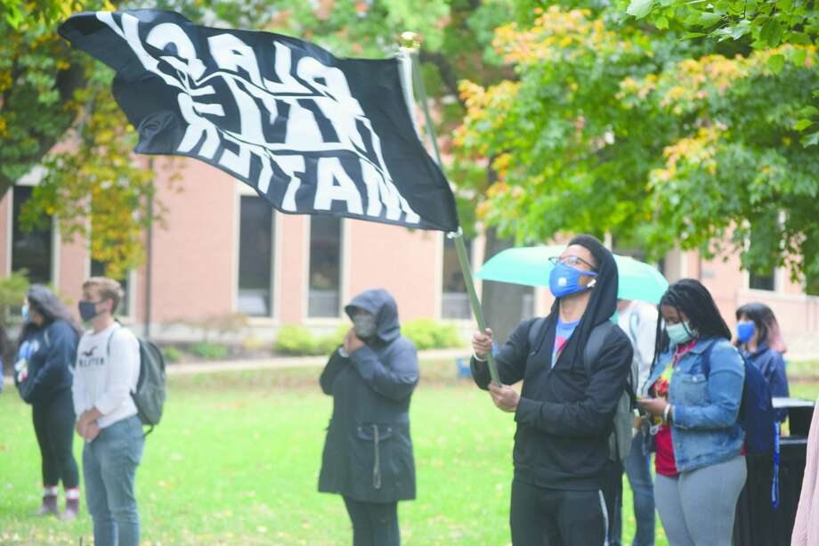 Members of the Illinois College community gather Monday on the northern quad of the school's campus, outside Tanner Hall, to support the Black Lives Matter movement. Photo: Samantha McDaniel-Ogletree | Journal-Courier