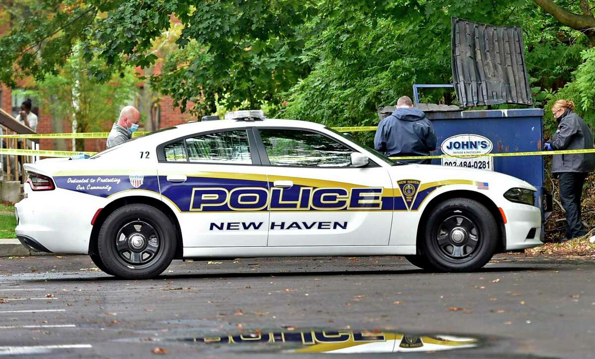 New Haven Police investigate a crime scene at 575 Dixwell Ave in New Haven on Oct. 12, 2020.
