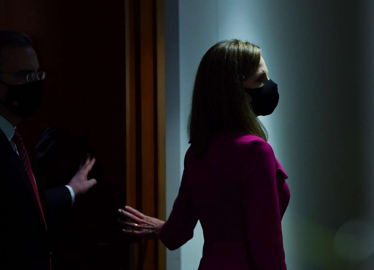 Supreme Court nominee Amy Coney Barrett leaving a Senate Judiciary Committee hearing Monday.