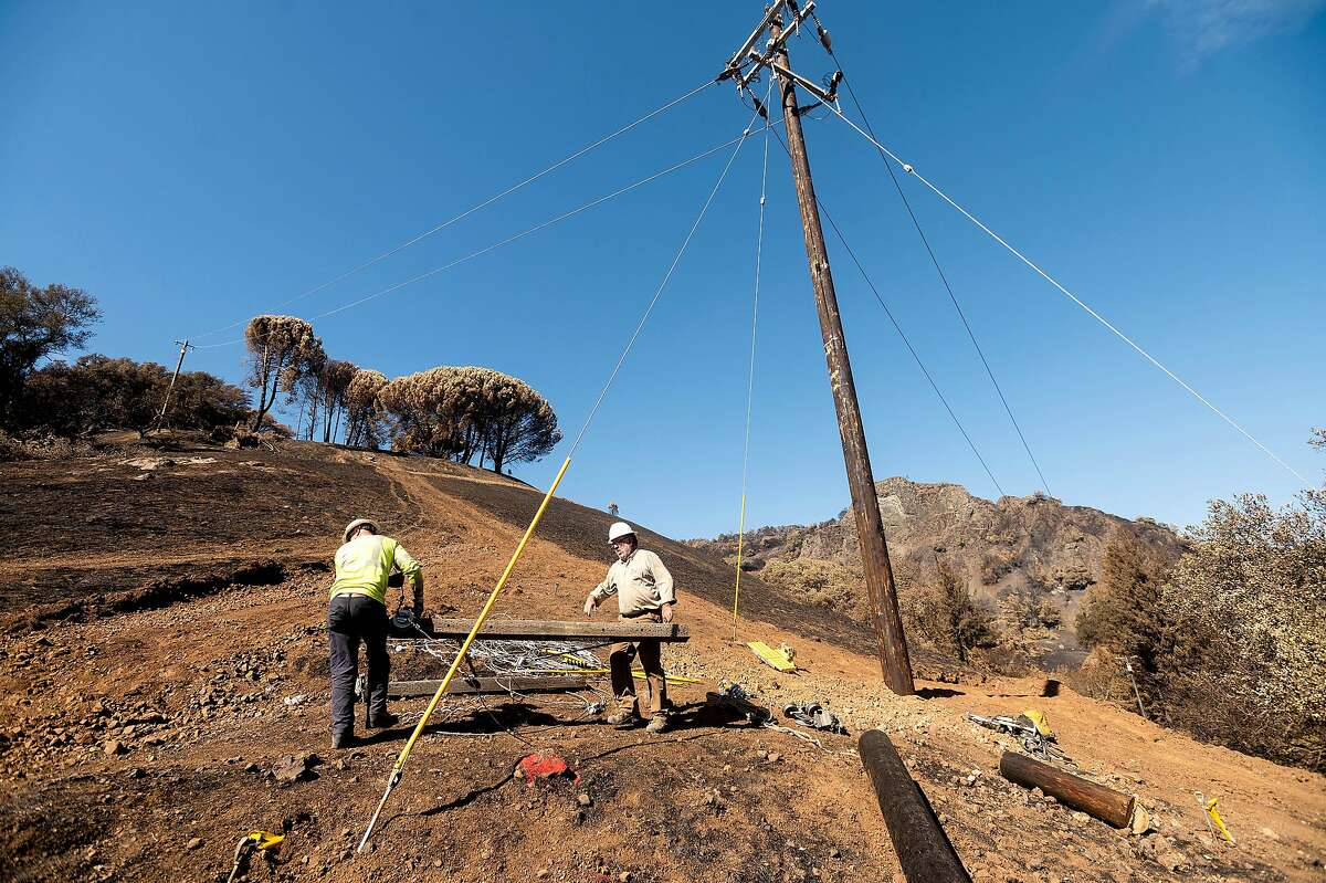 PG&E crewmen work to restore power along Los Alamos Rd. in Santa Rosa, Calif., on Monday, Oct. 12, 2020. Conditions ripened for an sustained and extreme risk of wildfires overnight Wednesday, but no sign of new flames emerged early Thursday - despite strong winds and record-setting temperatures throughout the North and East Bay hills.