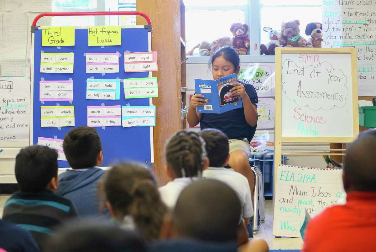 Kelso Elementary School second-grade teacher Cathy Hayes, pictured in 2018, leads peer reading time at the southeast Houston ISD campus. Kelso Elementary likely will be at the front of the line for renovations when HISD voters pass the district's next bond, though it remains unclear when they will get that chance.