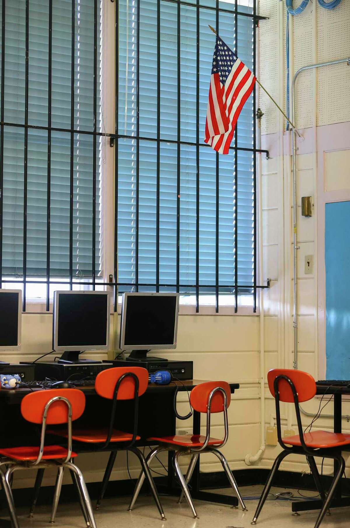 Bars cover the windows in the computer lab at Houston ISD's Kelso Elementary School in 2018. District officials have talked for three years about seeking a bond for renovations at Kelso and other campuses, but a series of leadership issues and the novel coronavirus pandemic have stalled those efforts.