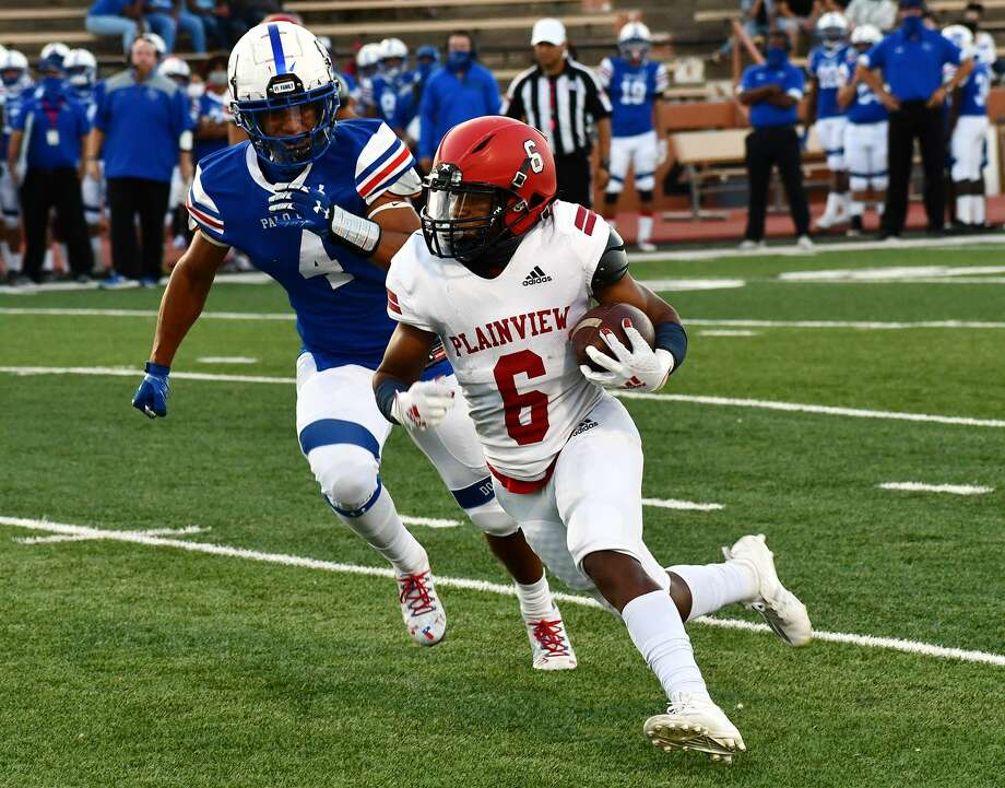Plainview's Karomo Collins (6) takes the ball around Amarillo Palo Duro defender Kameron Brown during their non-district high school football game on Oct. 1, 2020 in Dick Bivins Stadium in Amarillo. The sophomore running back has shown the ability to break off big plays for the Bulldogs early in the season. Photo: Nathan Giese/Planview Herald