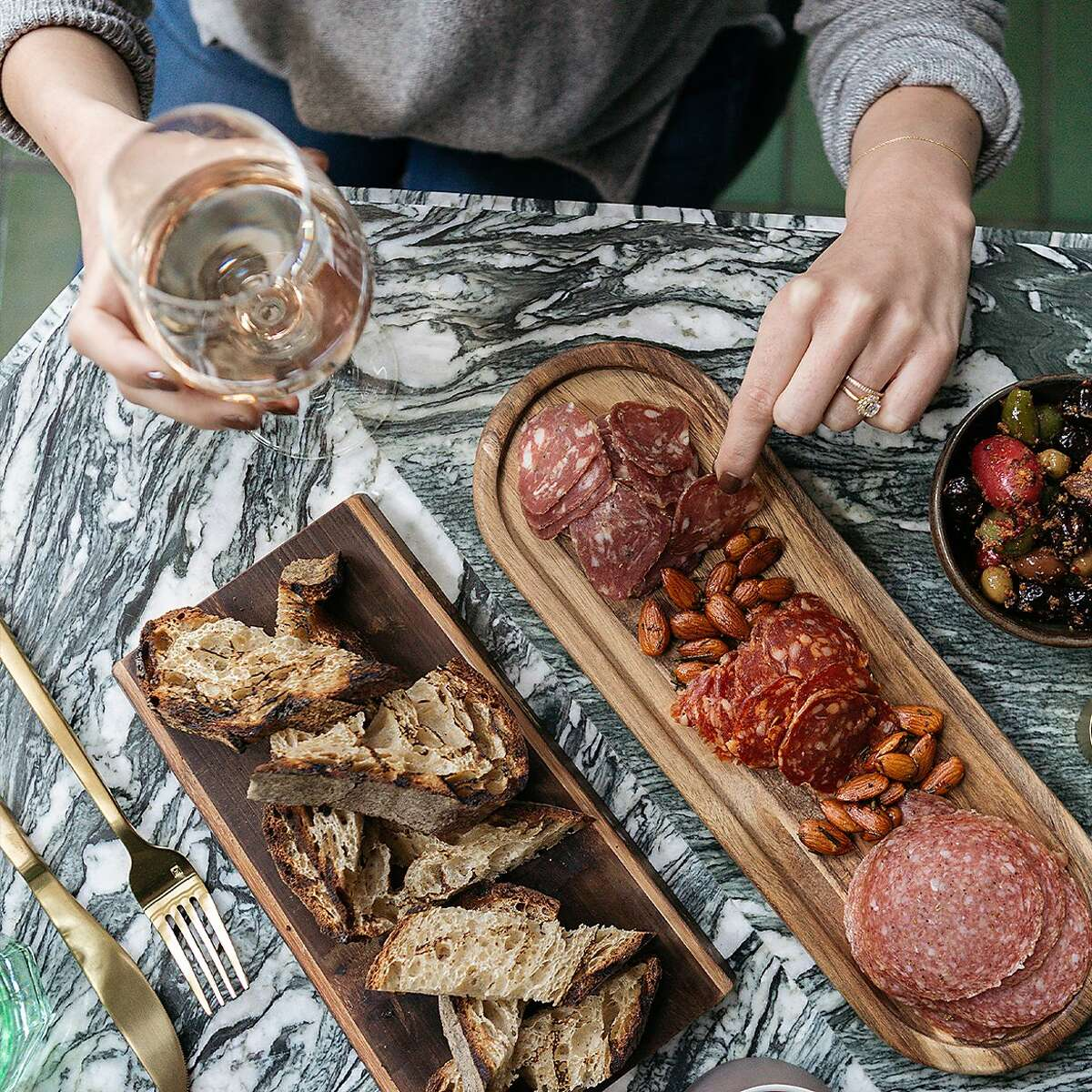 A spread of charcuterie is served at a pop-up earlier this year outside the Proper Hotel in San Francisco. The hotel is turning the outdoor dining space into its own permanent restaurant, Proper Patio.