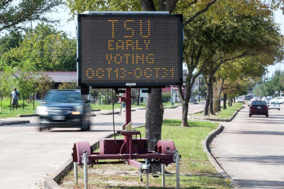 A sign along Blodgett touts an early voting location on the campus of Texas Southern University Monday, Oct. 12, 2020 in Houston. Early voting for the General Election begins Oct. 13 to Oct. 30 in Texas. Election Day is Nov. 3, 2020.