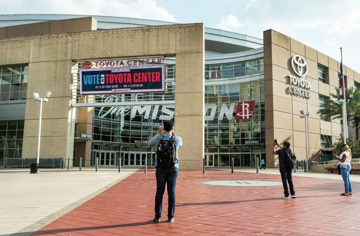 A Vote At Toyota Center sign is lit up in front of the arena Monday, Oct. 12, 2020 in Houston. The home of the Houston Rockets will be an early voting polling place. Early voting for the General Election begins Oct. 13 to Oct. 30 in Texas. Election Day is Nov. 3, 2020.