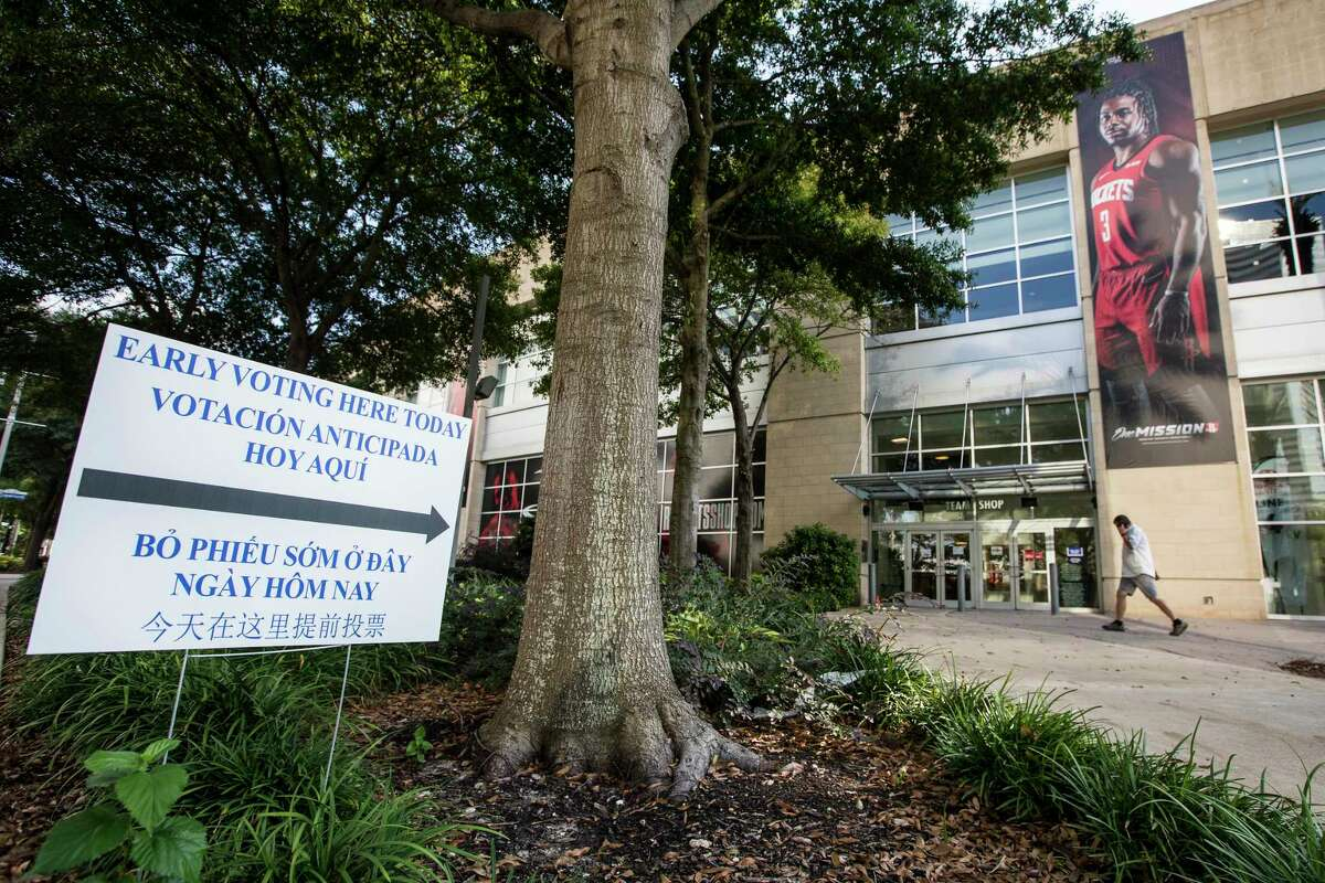 An early voting sign is place outside Toyota Center Monday, Oct. 12, 2020 in Houston. The home of the Houston Rockets will be an early voting polling place. Early voting for the General Election begins Oct. 13 to Oct. 30 in Texas. Election Day is Nov. 3, 2020.