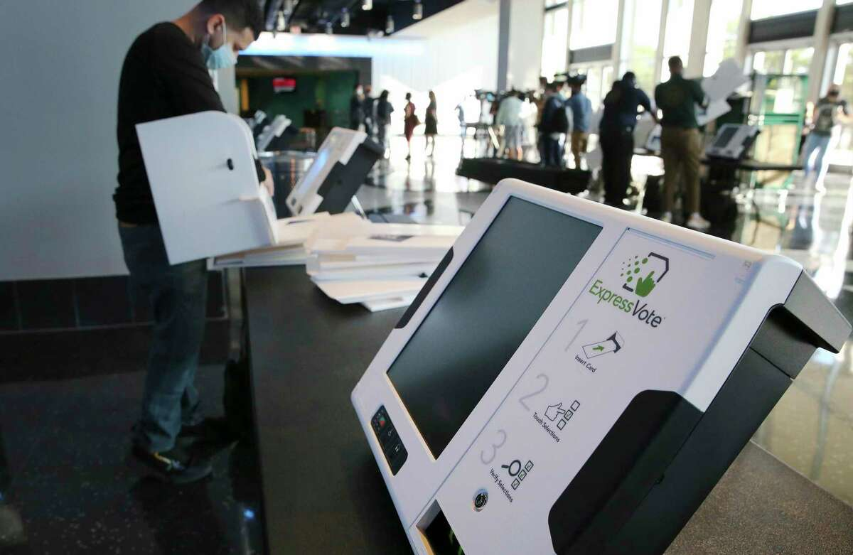Bexar County Elections officials set up voting machines at the AT&T Center in October. While turning the arena into a polling location was a public service, the $255,000 bill the Spurs have submitted to the county is disappointing.