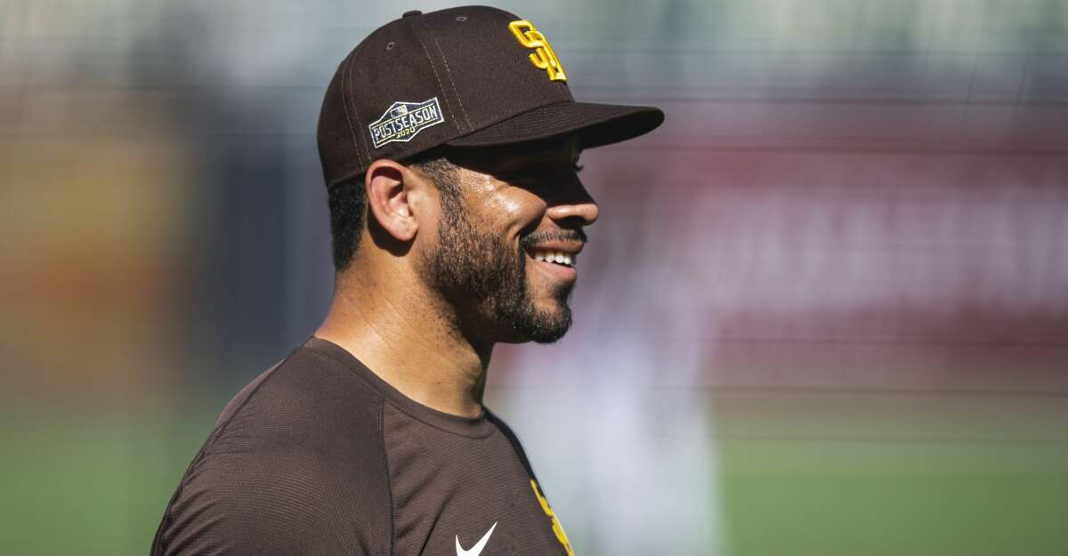 Tommy Pham #28 of the San Diego Padres laughs during their workout at PETCO Park on September 29, 2020 in San Diego, California. (Photo by Matt Thomas/San Diego Padres/Getty Images)