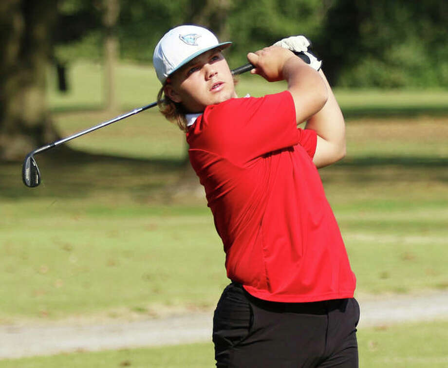 Roxana's Christian Floyd watches his tee shot on the back nine at Belk Park during last week's Roxana Class 2A Regional in Wood River. Floyd, a senior in his first season with Shells golf, advanced with an 85 and will play Tuesday in the Centralia Sectional. Photo: Greg Shashack / The Telegraph