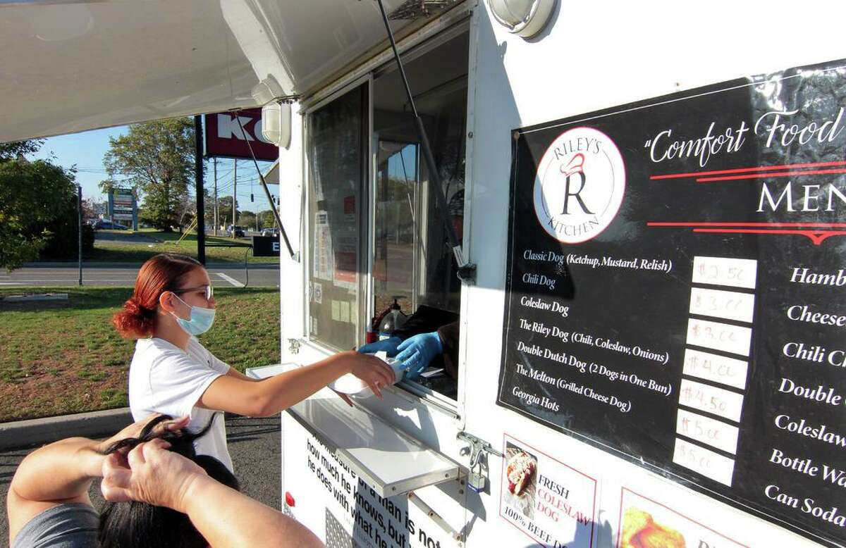 Riley's Kitchen, a food truck owned and operated by Melvin and Tanya Riley, parked at Kohl's parking lot in Orange, Conn., on Tuesday Oct. 6, 2020.